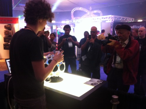AlphaSphere at The NAMM Show 2013, Anaheim, California. Last week myself and a couple of colleagues attended the largest American musical instrument trade show for the first time to exhibit the AlphaSphere, and it went incredibly well. We met many interesting people, including some who are very renowned and high-up in the MI and pro audio industry, as well as receiving extremely positive feedback.  Personal highlights included… being part of the NAMM Media Preview Day - a special pre-show event where only 20 of the 1700+ exhibitors are chosen to preview their products to a number of different media outlets; appearing on KTLA 5 - the main Los Angeles news channel; and being invited to a private demonstration of the upcoming MIDI HD protocol by the CEO of the MIDI Manufacturing Association.  Many blogs, videos, and images of our appearance at the show are starting to pop up in various places online, and I'm sure I'll be posting my favourites here soon. Plus I'd be very surprised if we don't have some fairly big news to announce soon as a result of the show, so watch this space…