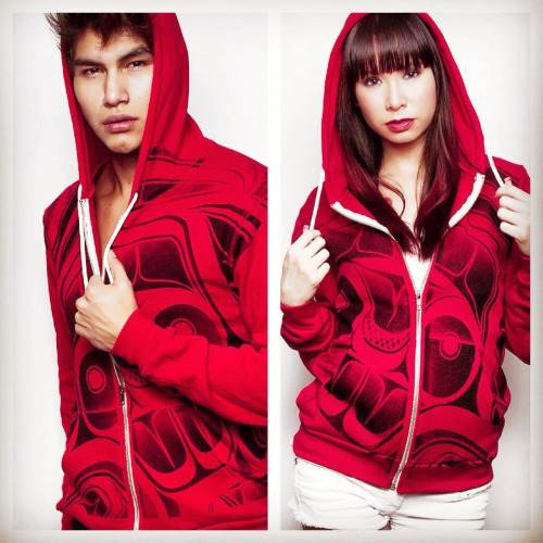"Red Sea Hoodie This cool unisex Eagle Hoodie was designed by Tahltan artist Alano Edzerza. It features a silk-screened black ""Red Sea"" design on a comfy red zip-up hoodie. A rising star in the fashion world, Edzerza also creates jewelry, sculpture, glass work, two-dimensional art, and large-scale installations. His designs are clean and striking, and he uses a Northern variation of Northwest Coast art, with a contemporary graphic art twist."
