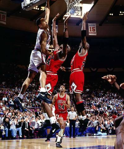 Two for One Tuesdays. John Starks, a right handed player, throws down a left handed dunk into the side of Horace Grant and Michael Jordan. Video of Starks dunk: