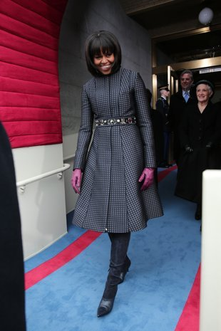 Michelle Obama in a Thom Browne coat and J.Crew belt. The boots are Reed Krakoff. (Getty Images)   (Photo by Joe Raedle/Getty Images)