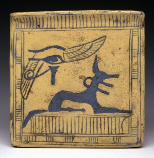 ancientpeoples:  Glazed Composition Pectoral c.1250 BC New Kingdom/Reign of Ramesses II Glazed composition pectoral: in the form of a pylon, or temple gateway. It depicts the god Anubis as a jackal, with a winged 'wedjat', or sacred eye, in the upper left-hand corner. The colour blue connotes resurrection, as often remarked, and the colour yellow alludes to the sun, itself a powerful symbol of resurrection. (Source: The British Museum)