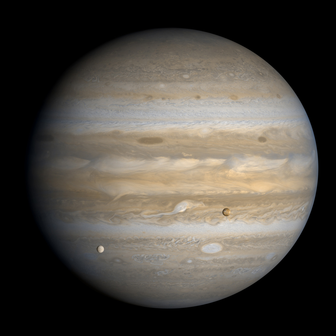 Jovian icy moon Europa and volcanic moon Io transit the turbulent face of Jupiter, in this image captured by Voyager 1 on February 27, 1979 from 4,536,010 miles away (image mosaic credit: NASA/JPL/Björn Jónsson).