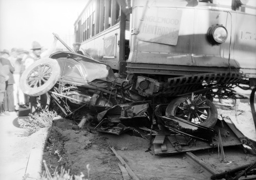 "An automobile lies mangled beneath a Los Angeles Railway streetcar in Leimert Park on November 27, 1929. According to a Los Angeles Times report, the streetcar was traveling 25 miles per hour down Leimert Blvd. when the automobile drove directly across the tracks. The automobile's driver, George Conley, died instantly, but the trolley dragged the much lighter vehicle nearly 90 feet before coming to a complete stop. Conley, the Times reported, had previously portrayed Abraham Lincoln on film. This is one of more than 30,000 photos from our ""Dick"" Whittington Collection that we've recently digitized with support from the National Endowment for the Humanities."