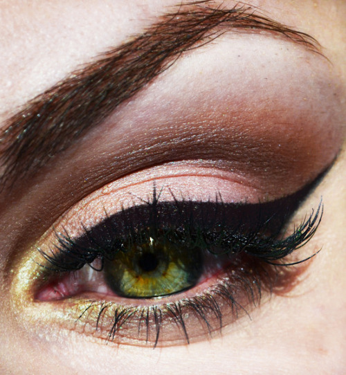 Joanna J.'s eyes pop with a beautiful rose eye shadow and winged eye liner!