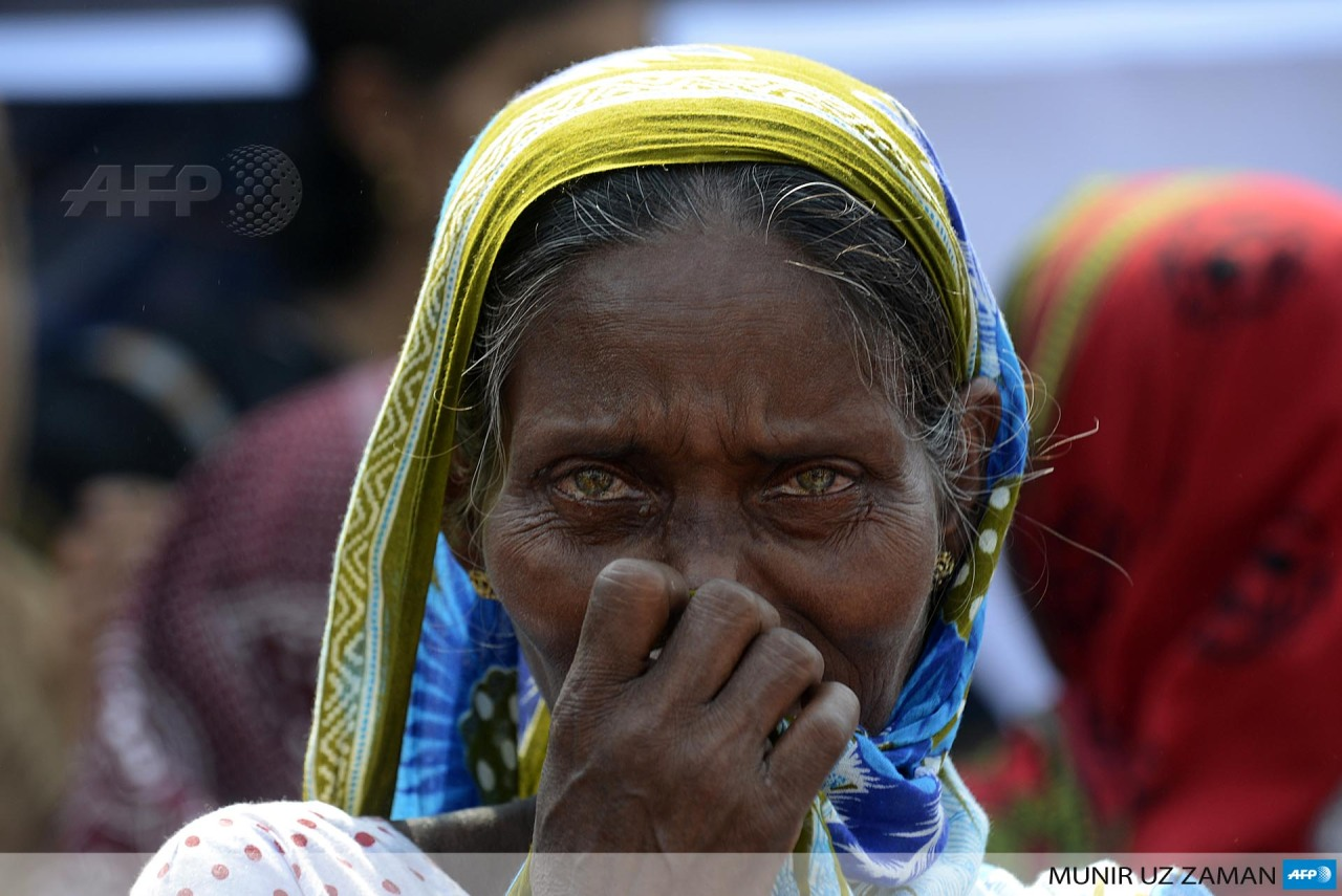 BANGLADESH, Dhaka: A Bangladeshi mourner and relative of a victim of the Rana Plaza building collapse reacts as she takes part in a protest marking the first anniversary of the disaster at the site where the building once stood in Savar on the outskirts of Dhaka on April 24, 2014. The Rana Plaza building collapsed on April 24, 2013, killing 1138 workers in the world's worst garment factory disaster. Western fashion brands faced pressure to increase help for victi