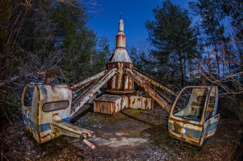 abandonedjapan:  Forgotten helicopter ride in the forest patiently waits for the next ride.
