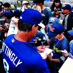 Donnie Baseball signs autographs for Little League team.