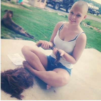 This is my friend Alexis. She shaved her head in support of her Aunt who is going through cancer. She is truly beautiful and has a big heart. I have so much respect for her right now because I've lost a lot of family to cancer. You are truly beautiful Alexis