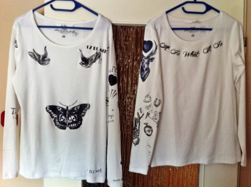 harry's and louis' tattoo shirts <3