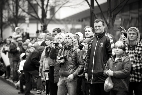 Title: Caught My Eye.Outtake from the Gazelle Girl Half Marathon in Grand Rapids, Michigan. While it was a spring race…. race day was visited by rain, hail, and of course snow! Pure Michigan.Of course, no matter the weather conditions there is ALWAYS time for a bit of street photography.