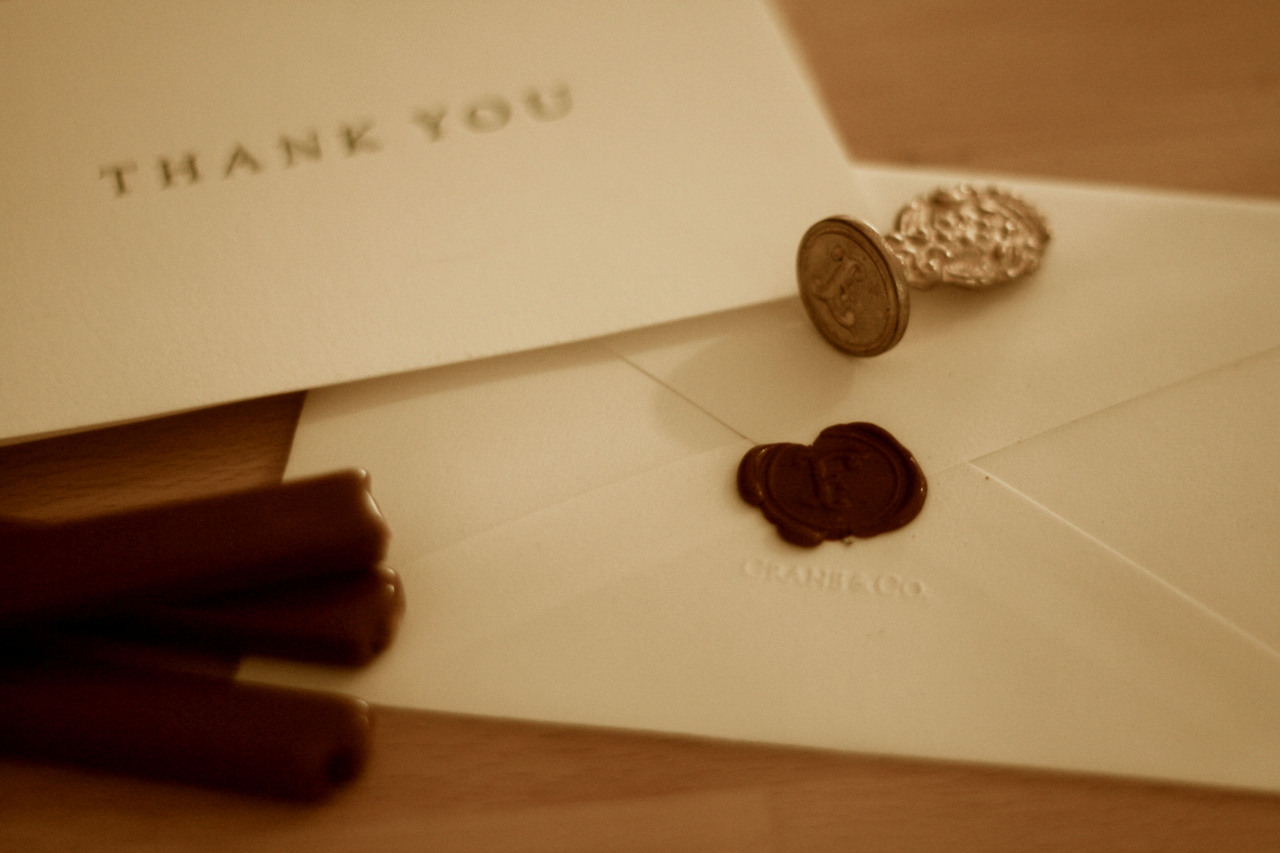 The Art of Thank You  In a time when nearly everything has been made digital, it is those things that harken back to an earlier time that carry more gravity. We pay significantly more for our hand-made denim, our tube powered amplifiers, or locally sourced cheese. When it comes to thanking those who have brought you joy, there is only one option: the thank you card.  Purchase a high quality, simple set; the paper should be thick and sturdy. This one is from Crane & Co. and features only the necessary words on a plain card. Hand write, from the heart, and hand address. Finish with a bit of sealing wax, and perhaps a unique stamp. Details such as these show you put as much though into gratitude as the recipient gave to you.
