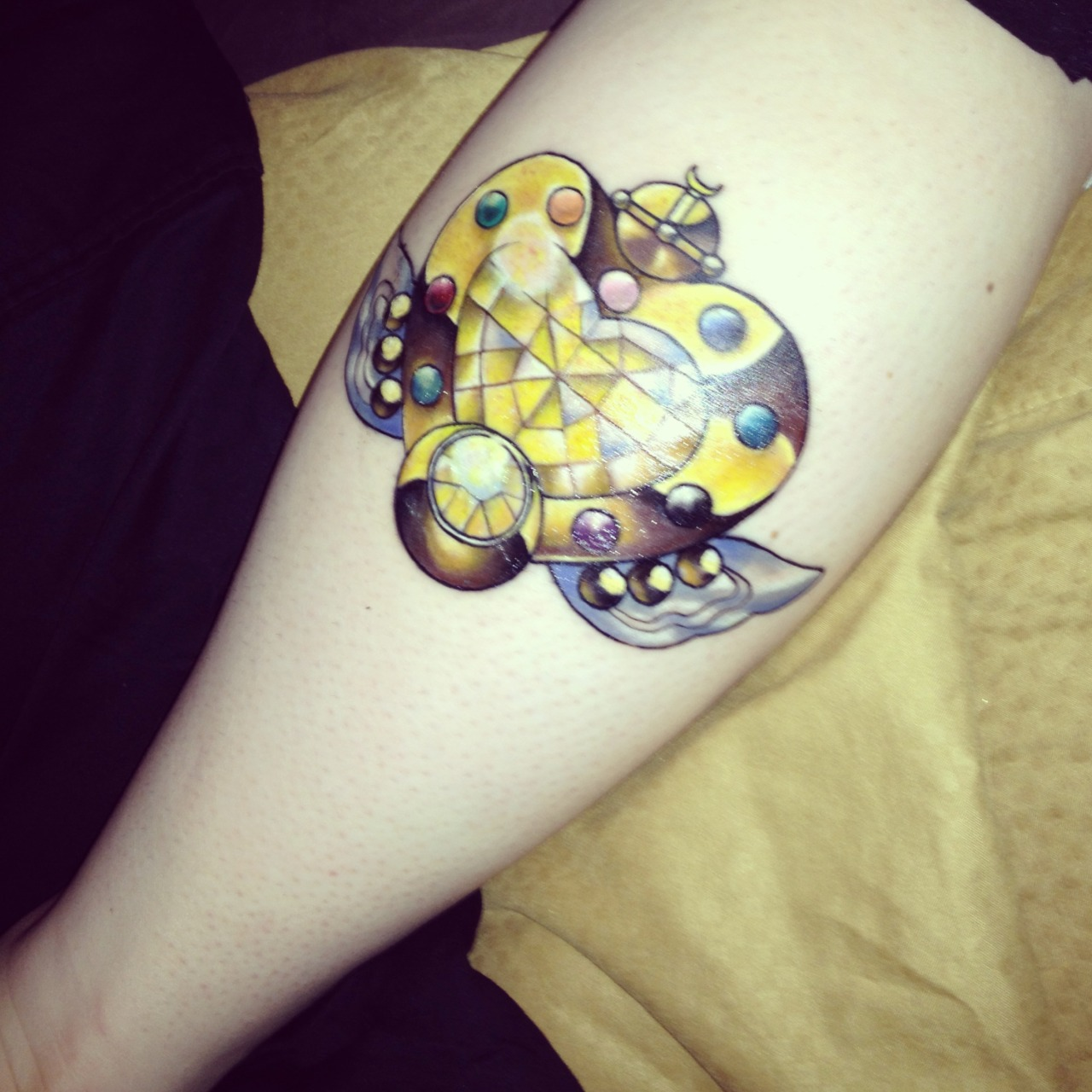 fuckyeahtattoos:  This was one of my first big tattoos (other than a small heart tattooed on my pinky) and has officially gotten me addicted to wanting more. It took me a while to settle on my first tattoo because I couldn't really find the perfect idea for what I had in mind. My grandmother, who was extremely dear to me and my absolute best friend, passed away back in April of 2005. She survived lung cancer only to have a fatal heart attack less than a month later. She took care of me quite regularly as a child. She would watch Sailor Moon with me every day with me when I was younger and I believe that is honestly what got me so interested in Sailor Moon all together! It is safe to say that I am a die-hard moonie because of her, so I decided on the final transformation brooch that appears in the anime (not the manga). The Eternal Moon Article! I felt that this brooch seemed quite appropriate for my eternal love for both my grandmother and Sailor Moon! ♥ Done by James Hurley at Roustabout Tattoo & Body Piercing in Cookeville, Tennessee. (Now works at Eclectic Art Tattoo Gallery in Lansing, Michigan) https://www.facebook.com/james.hurley.3572