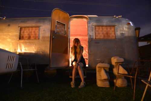 alldaymakebelieve:  The airstream trailer was one of my favorite bedrooms ever - somehow I was given the key to it and I had the palace all to myself for a few weeks. The inside was all wood and glowing lights. It smelled like palo santo and sounded like crickets chirping in the warm summer nights.