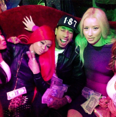 "Blac Chyna: ""Happy New Years from Chyna, Tyga, and the baddest chick Iggy"" [via Twitter]"