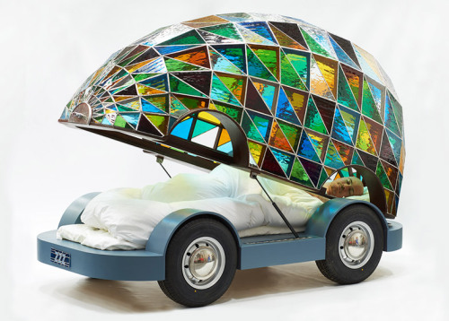 """archiemcphee:  London designer Dominic Wilcox just unveiled his visionary concept for the future of transportation. Behold the beautiful Stained Glass Driverless Sleeper Car of the Future. Traveling in this beautiful vehicle must be like taking a ride inside a giant Fabergé egg, which, of course, sounds incredibly awesome. Wilcox presented his driverless glass car prototype at the London Design Festival 2014:  """"In the future it will be safer to drive in a driverless car than it will in a manual car,"""" said Wilcox. """"Therefore we don't need the protection systems that are built into contemporary cars. We can just have a shell of any design."""" The designer imagined a future where all cars were controlled by computers that would eliminate collisions and accidents, meaning everyday vehicles would no longer need to be designed for safety.  Wilcox proposes that a perfectly safe self-driving car is a car that can be made out of something as fragile as glass and used as, in the case of this prototype, a sleeper car. It contains a cozy bed in which the rider can sleep while being driven to their destination. But there are many other possibilities besides a mobile bedroom. Liberated from the responsibility of driving, people could have cars that served as mobile offices, gyms, dining rooms, or lounges. The only limits are your imagination and, of course, your budget. In addition to unveiling this daring prototype, Wilcox also launched a concept website, called TaxiRobot, where users can customize and order their own driverless cars for a variety of functions and featuring all sorts creative exterior designs. Click here to watch a video about Dominic Wilcox and his stained-glass driverless car. Photos by Sylvain Deleu Head over to Dezeen for additional information about this fabulous futuristic concept car.  I'm sure this will be the first of a long series of """"awesome things to replace my car with."""""""