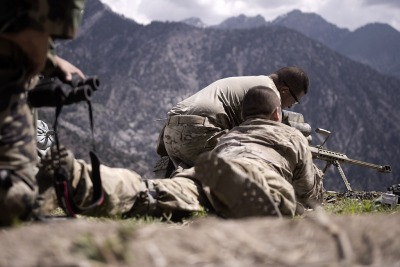 The 50 A United States Army sniper team set up a rifle during a mission in Nuristan province, Afghanistan, April 15. Afghan National Army Commandos and coalition Special Operations Forces, the first to visit that area in more than two years, defeated insurgent forces overrunning a village. (U.S. Navy photo by Mass Communication Specialist 2nd Class Clay Weis / Not Released)