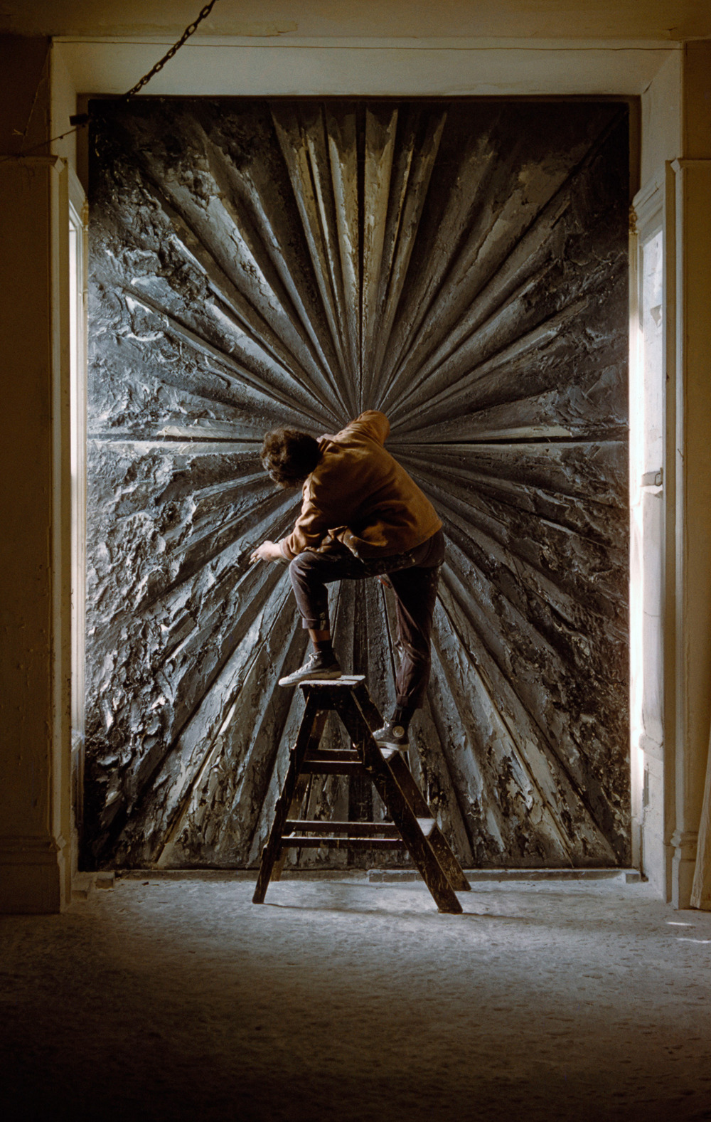 "likeafieldmouse:  Jay DeFeo - The Rose (1958-69) ""The story of Jay DeFeo and The Rose is both a cautionary tale of obsession and an inspiring tale of determination and belief. She began working on The Rose in 1958. She was 29 years old and for the next eight years, she did little else but sit on a stool in her studio, smoking cigarettes, drinking brandy while she painted and scraped away at her vision. First titled The Deathrose, then The White Rose and finally just The Rose, DeFeo only stopped working on the painting when an increase in rent forced her from her studio. By then it was 1966, her marriage was ending, she was in fragile physical and mental health, and The Rose had become too large to fit out the door.  At nearly 12 feet high and in places eight inches thick, The Rose was constructed from layer upon layer of built up and scraped away black and white paint. DeFeo added mica chips to the paint and so The Rose has its own interior light.""  Then sad and awesome existed together in a series of paintings."