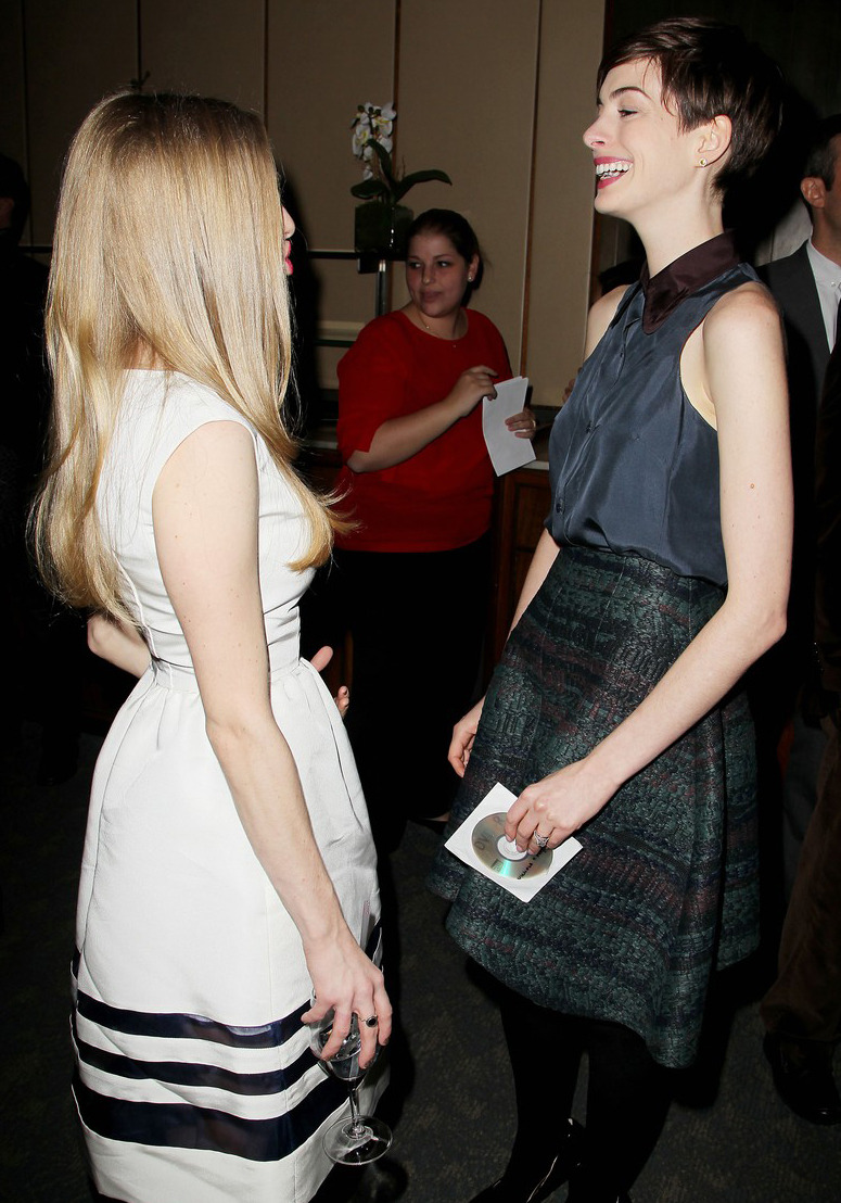 suicideblonde:  Amanda Seyfried and Anne Hathaway (in Carven) at the luncheon for Les Miserables in NYC, December 11th  KISS HER!