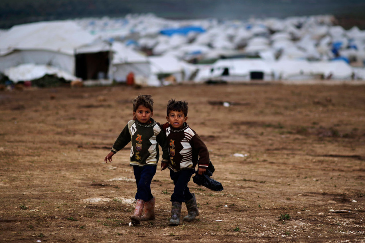 Dec. 10, 2012. Syrian boys, whose family fled their home in Idlib, walk to their tent at a camp for displaced Syrians, in the village of Atmeh, Syria. (Photo: Muhammed Muheisen—AP) From continued protests in Egypt and a mass wedding in Indonesia to Syrian refugees in Turkey and the Pope's first tweet, TIME presents the best images of the week. See more on LightBox.