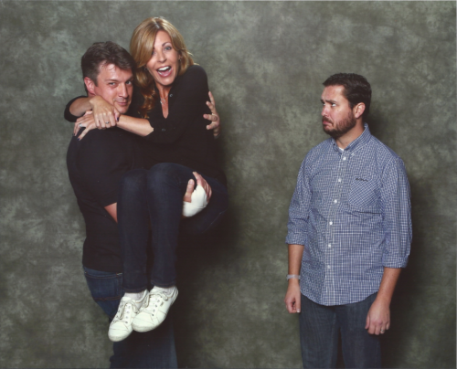 wilwheaton:  in which nathan fillion sweeps anne wheaton off her feet  When I finished one of my photo ops in Ottawa, Nathan Fillion was doing one of his in the photo…  View Post  This is a thing of beauty.