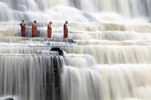 tiredfromsleeping:  MEDITATING MONKS AT PONGOUR FALLS Photograph by DANG NGO
