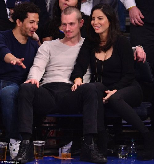 Joel Kinnaman and Olivia Munn, NY Knicks Game, Madison Square Garden, 12/14/13 They have been together since December 2011, so a happy second anniversary to them!