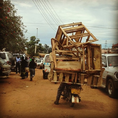 lisamarie620:  One man carrying all of these chairs on a motorcycle.  (at Clock Tower)