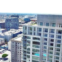 If you look closely you see a roof top spin class at #717olympic.  #DTLA #losangeles #LA #nofilter #niceview  (at APEX. The One.)