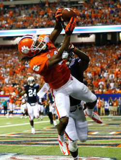 WR DeAndre Hopkins out of Clemson is now a Houston Texan after being selected 27th in the 2013 Draft. This is what most people have demanded and expected for the Texans. Another receiver to help distract and keep defenses honest for big WR Andre Johnson. If you're a fantasy football player, watch Johnson do well yet again this year, barring any injuries. Good on Houston.