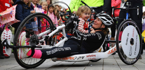 Claire Lomas and her daughter after finishing her Hand Bike challenge.