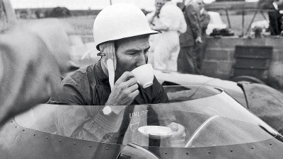 sharonov:  June 1959: Stirling Moss enjoys a cup of tea in the cockpit of his Vanwall racing car.