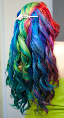 This is what my rainbow curls looked like from the back.   Manic Panic — Atomic TurquoiseManic Panic — Electric BananaManic Panic — Electric LavaManic Panic — Electric LizardManic Panic — Enchanted ForestManic Panic — Hot Hot PinkManic Panic — Purple HazeManic Panic — Rockabilly BlueManic Panic — Ultra Violet