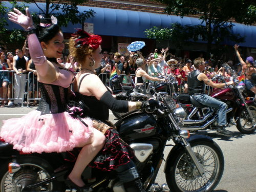 beautyandthebutch:  I loved these girls with the Dykes on Bikes. Usually all the girls are butches and wearing leather…but these chicks are hot as HELL in their corsets! Beauty said this is how she would ride in the parade. ;D -butch ps - all these Gay Christmas photos were taken by me, so please don't reblog them without a link back.