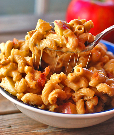 "prettygirlfood:  Butternut Squash Mac n' Cheese with Bacon, Caramelized Onions, and Apples Ingredients ½ box whole grain elbow macaroni (about 2.5 cups dry) 1 cup canned butternut squash puree ¼ cup + 2 tablespoons evaporated milk ¼ cup chicken or vegetable broth 1 oz low fat cream cheese 1 teaspoon salt ½ cup shredded cheddar cheese 1 tablespoon butter ½ cup onions, sliced thinly 1 large crispy apple, chopped or grated 4 tablespoons crumbled bacon Instructions Heat butter in a skillet over low heat. When melted, add onions and let caramelize for at least 30 minutes for the best flavor. Keep heat on low/low-medium. Cook the pasta according to directions. Drain and return to pan over low heat. Add butternut squash, chicken broth, evaporated milk, and cream cheese. When combined, add in salt. Add onions and apples to the pasta. Stir to combine and add a tablespoon more broth or milk if needed. Just before serving, mix in cheese and stir until melted. Top each serving with 1 tablespoon bacon. Notes Because there's very little butter, it can ""dry out"" quickly, especially once off the heat. Add a tablespoon of water, milk, or broth if you need to get it back to its original creaminess.  Serves 4.  That would serve only 1 in my household; Me."