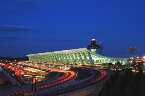 architecturealliance:Dulles International Airport, is an international airport in the Eastern United States, located in Loudoun County and Fairfax. Opened in 1962, it is named after John Foster Dulles (1888–1959),[4][5] the 52nd U.S. Secretary of State who served under President Dwight D. Eisenhower. Dulles is the primary airport for long distance and international flights for the Washington, DC area. Eero Saarinen was the designer of the main terminal, later added to but still an amazing piece of work. Arriving passengers see little of it, however, and landing at a gate in the outer areas, especially Concourses C & D (used mostly as a hub by United Airlines and its partners), is dispiriting. Most Third World countries have better terminals for their Capital cities!