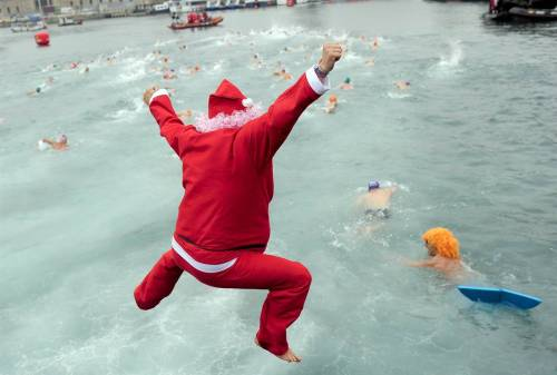 Christmas in Barcelona Photo: A swimmer jumps in the cold water off Barcelona, Spain, as he takes part in the 103rd Christmas Cup swim on Dec. 25. About 400 people participated in the 200-meter race in Barcelona's Old Harbor. (Josep Lago / AFP - Getty Images) More images of Christmas around the world at NBC News.