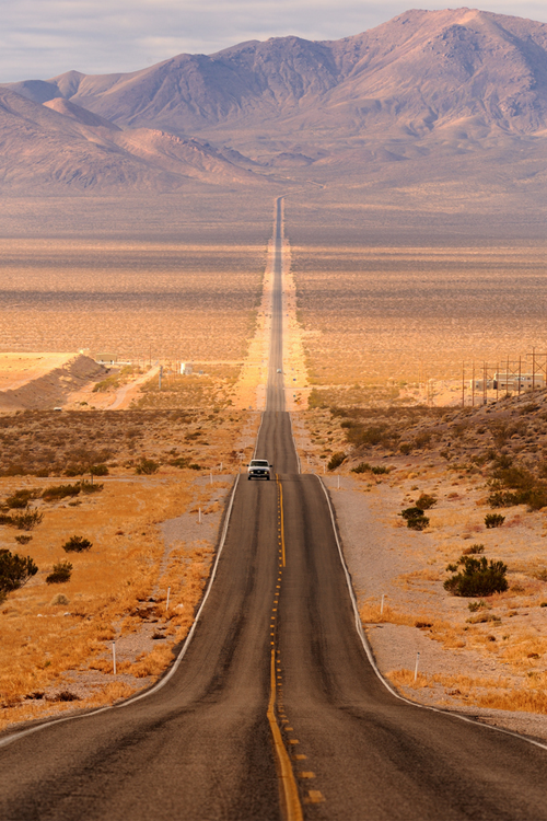 Long desert highway by Glenn Nagel