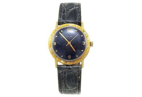 1960s 14K gold round Elgin wristwatch with white gold highlights in the bezel and navy blue enamel dial. Placed on a new gray genuine crocodile strap. Marked: Elgin on the face and movement. by Ruby + George on One Kings Lane Vintage and Market Finds