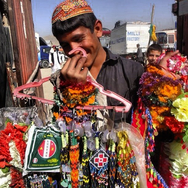flower and charm seller - Afghanistan.