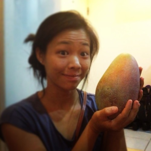 That time I held the heavenly giant #mango from my Grandma's backyard. #thailand