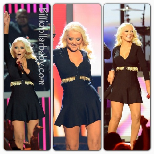 Christina Aguilera performs in Versace & Hervé Léger at the 2013 BillBoard Music Awards Christian Aguilera performed Feel This Moment with Pitbull at the 2013 Billboard Music Awards.  She wore a black Versace top and  black/gold Hervé Léger flare skirt.