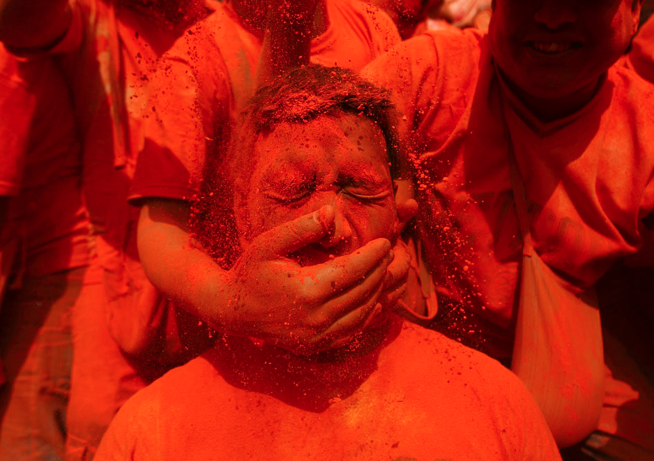 "A man is smeared with vermillion powder while celebrating ""Sindoor Jatra"" vermillion powder festival at Thimi, near Kathmandu April 15, 2013. The festival is celebrated to mark the Nepalese New Year and the beginning of spring season in Nepal.REUTERS/Navesh Chitrakar"