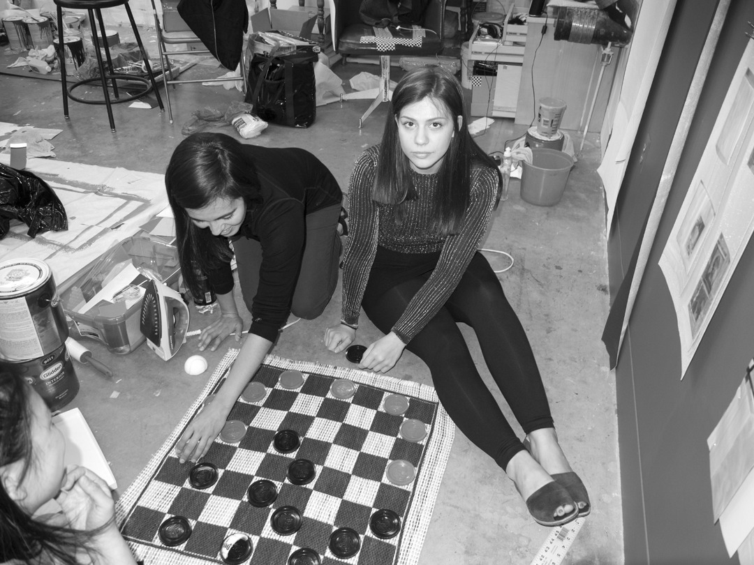 Darja playing checkers in her studio last night