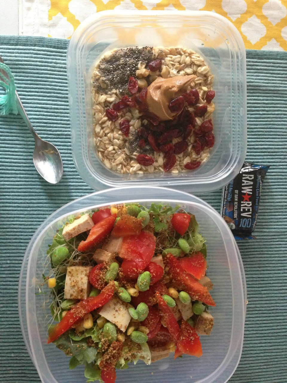 Today's packed meals:   - oatmeal with chia seeds, dried cranberries, smooth organic peanut butter and walnuts for crunch.  - salad with spring mix & kale, smoked tofu, edamame, corn, red pepper, tomatoes, alfalfa sprouts, flax seed blend and a little olive oil.  - snack of a RawRev sample bar (raw organic chocolate coconut energy bar thing, courtesy of Consmr)