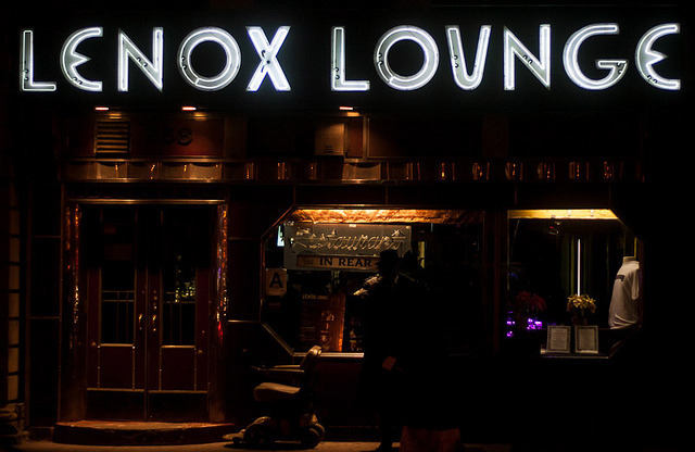 Lenox Loungein Harlem on Lenox Avenue/Malcolm X Blvd between W 124th & W 125th Streets The Lenox Lounge is closing at the end of the month. There are conflicting reports about how radical the change will be when it reopens under new owners, but it will certainly change. I am, once again, kicking myself for not visiting an NYC landmark until the end of its era.  The Lenox Lounge is a gem inside and out. I didn't go to hear music, just sat at the bar after work, surrounded by affable working stiffs who, like me, needed a stiff drink. Unfortunately a mild beer is the most I can handle these days, but at the happy hour price of $3 a bottle, it hit the spot well within budget. The crowd was congenial without being nosy or noisy, and after a stressful work day, nothing could have been better. But the city's changing and the Lenox Lounge with it, and I have a bad feeling that it's going to turn all fancy-pants, and not be the kind of place it's OK to sit and drink a $3 beer for an hour in the company of regular people. The neon sign is one of my favorites. I love the unique lettering, especially the crescent-moon Es. I can only hope the new owners love the sign half as much as I do, so it will remain as a memorial to the cool spot that once stood just behind it. I hope I'm wrong, I hope things will continue on at least mostly the same, but seeing what's happened to similar places (like Fedora's), it doesn't seem likely, does it? Go while you still can. RIP Lenox Lounge, 1942 - 2012 ………………………………………………… More sad neon news coming up in a few days. Help document the neon that's still shining (and not just in NYC) in the Project Neon Flickr pool! Oh, and I've been trying to post more to the Project Neon Facebook page if that's your thing.