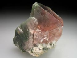 'two-faced' octahedral crystal of pink Fluorite from this renowned locality - one side is transparent pink and the other is heavily included with green Chlorite.~Goscheneralp, Goschenen Valley, Uri, Switzerland via