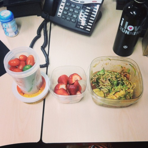 Desk lunch: veggies (tomato and mini cukes) with hummus, strawberries, an zucchini noodles with tomato sauce and avocado.