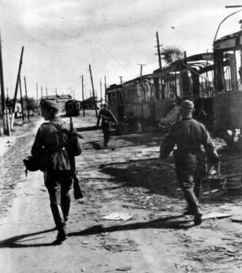 demons:  German soldiers passing burned out trams in Stalingrad, 1942
