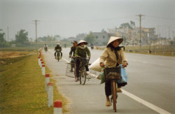 Between Ha Noi and Ha Long Bay, Viet Nam We should have conical bike helmets here.