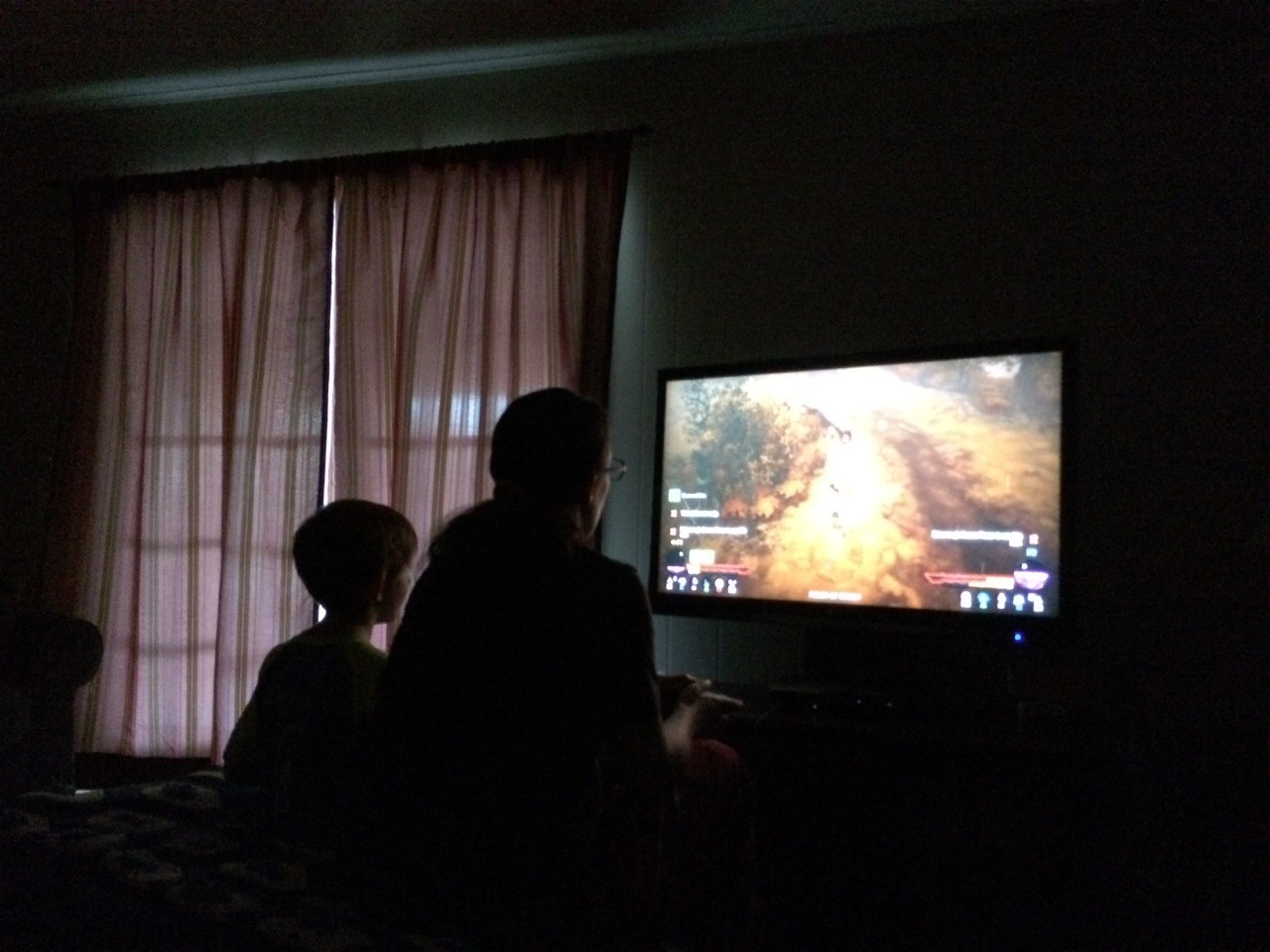 My wife is playing Diablo with our son. She is such a good mommy.